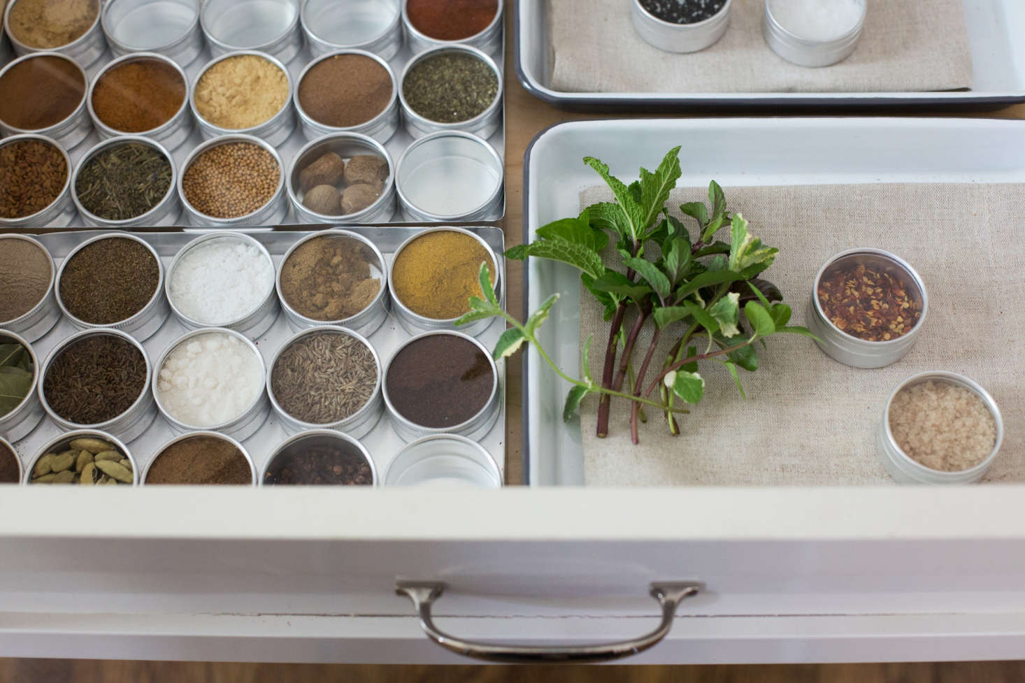 Michelle found the perfect canisters for holding her spices at a jewelry supplies store. See her clever hack inWhat's Inside: A Surprising Spice Drawer Solution. Photograph by Mimi Giboin.