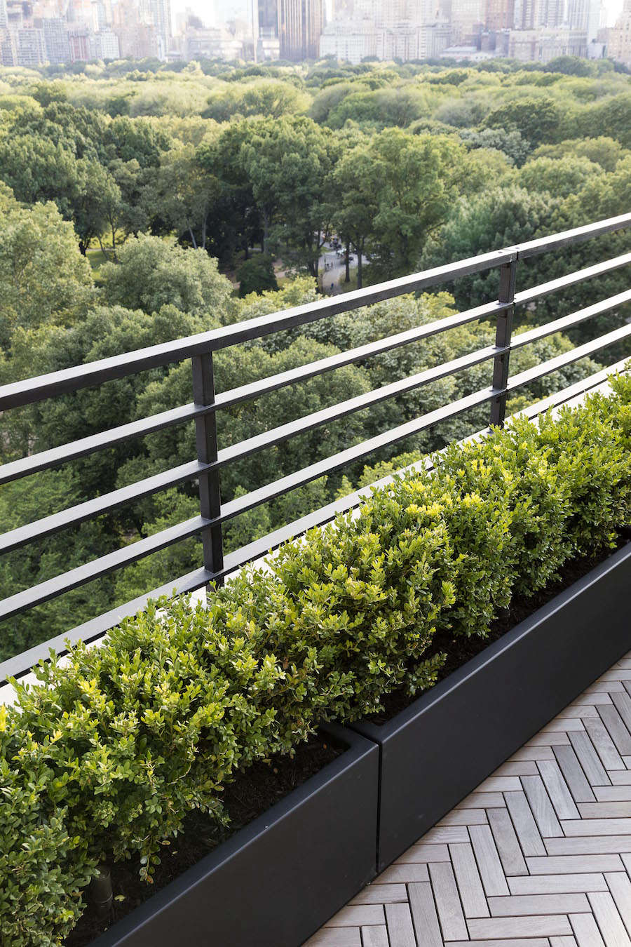 The unadorned powder coated planters were chosen for their light weight and durability and were custom built.