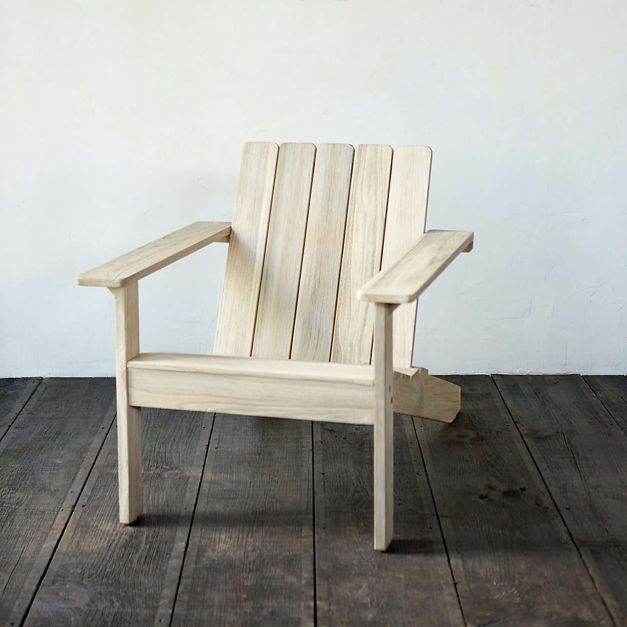 A Teak Adirondack Chair Pre Treated To Resist Wear From Sun And Rain Is $598