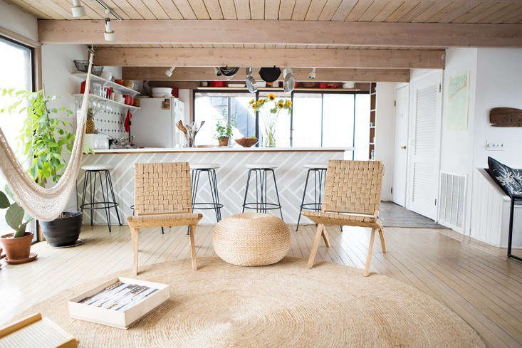Natural fiber rugs, like this one in the houseboat home of Fredericks & Mae founders Gabe Cohen and Jolie Signorile, not only reflect the casual vibe of the coast but also they're excellent sand traps. See Rehab Diary: The Ultimate Houseboat in NYC. Photograph by Douglas Lyle Thompson.