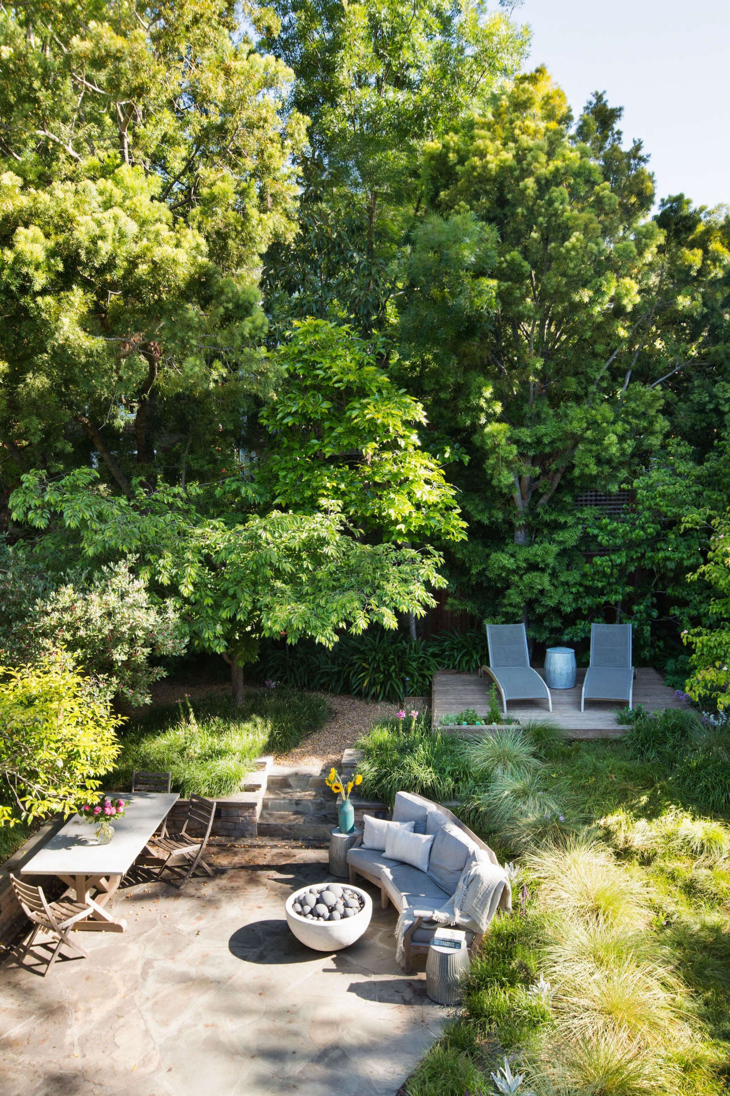 From a bedroom balcony you look down into a backyard meadow full of flowing grasses