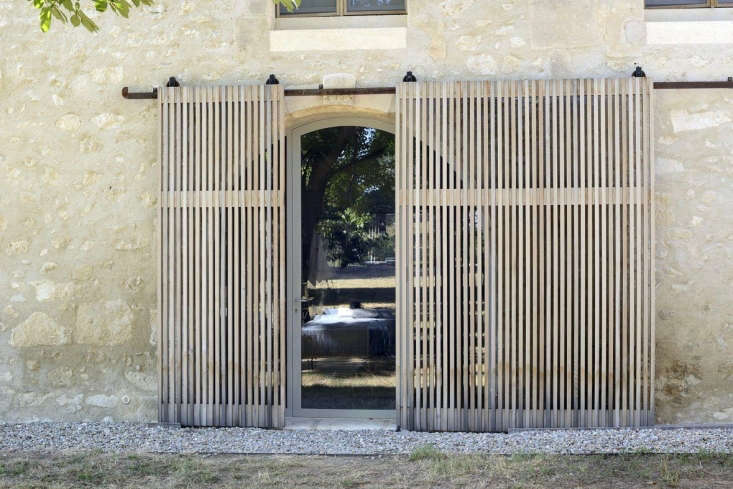 cedar sliding screens farmhouse provence Photograph by Katrin Vierkant, unless noted, all courtesy of LSL Architects.