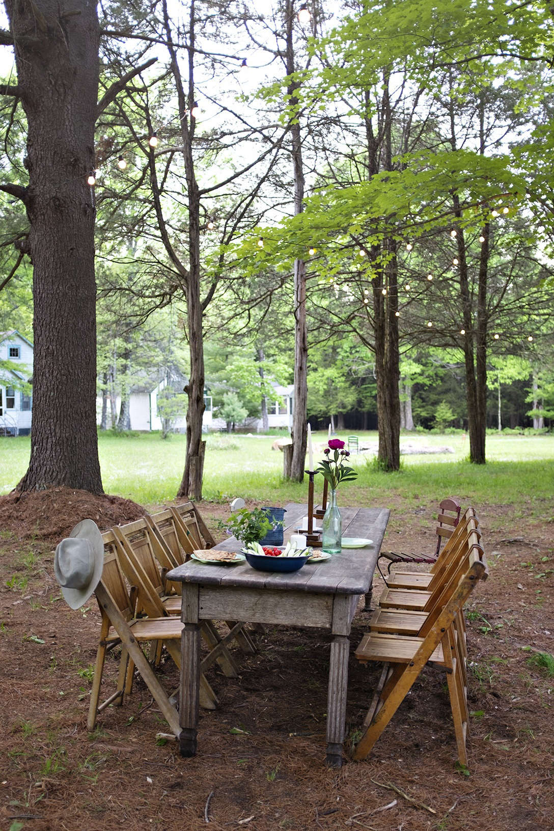 Who wants to have to eat while standing up and balancing a full plate of food? Do your guests a favor and provide seating and a surface on which to rest their plates. This wholly charming dining setup, thanks to indoor furniture brought outdoors, is courtesy of the Glen Wilde. This week, its proprietors shared How to Open Up the Summerhouse for the Season.