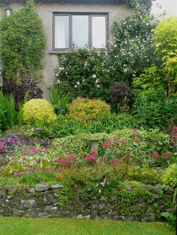 above tricia lyon entered a modest modern garden on the edge of the lake district in kendal england chosen by michelle slatalla the terraced beds are a