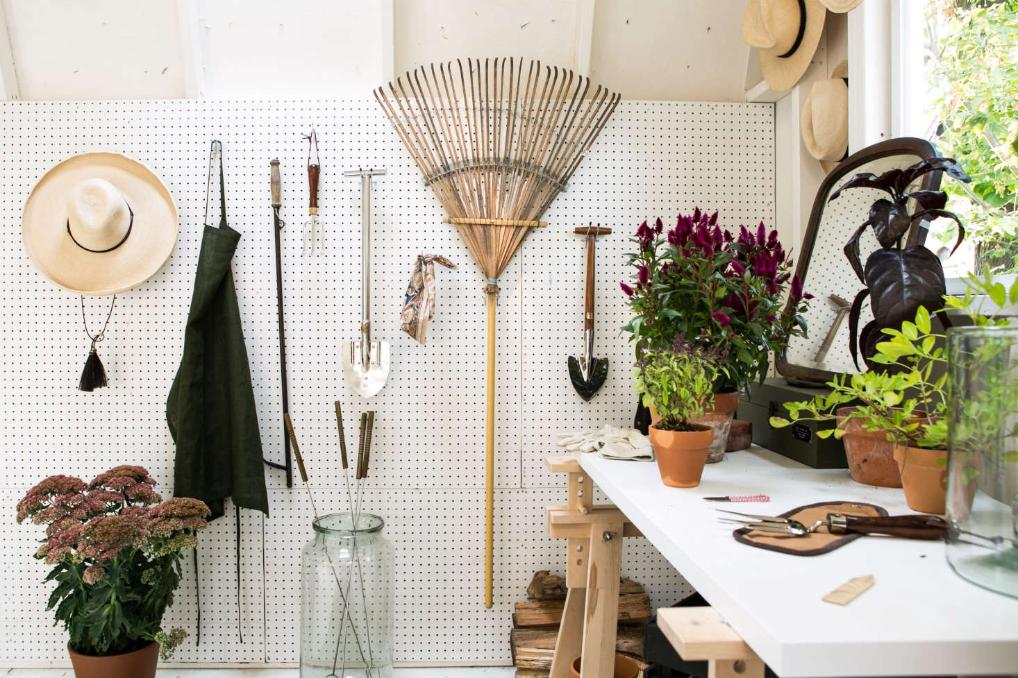 A wall of pegboard is flexible storage; just move the hooks to make room for new tools to hang. See more in Before & After: A Garden Makeover in Michigan for Editor Michelle Adams. Photograph by Marta Xochilt Perez.
