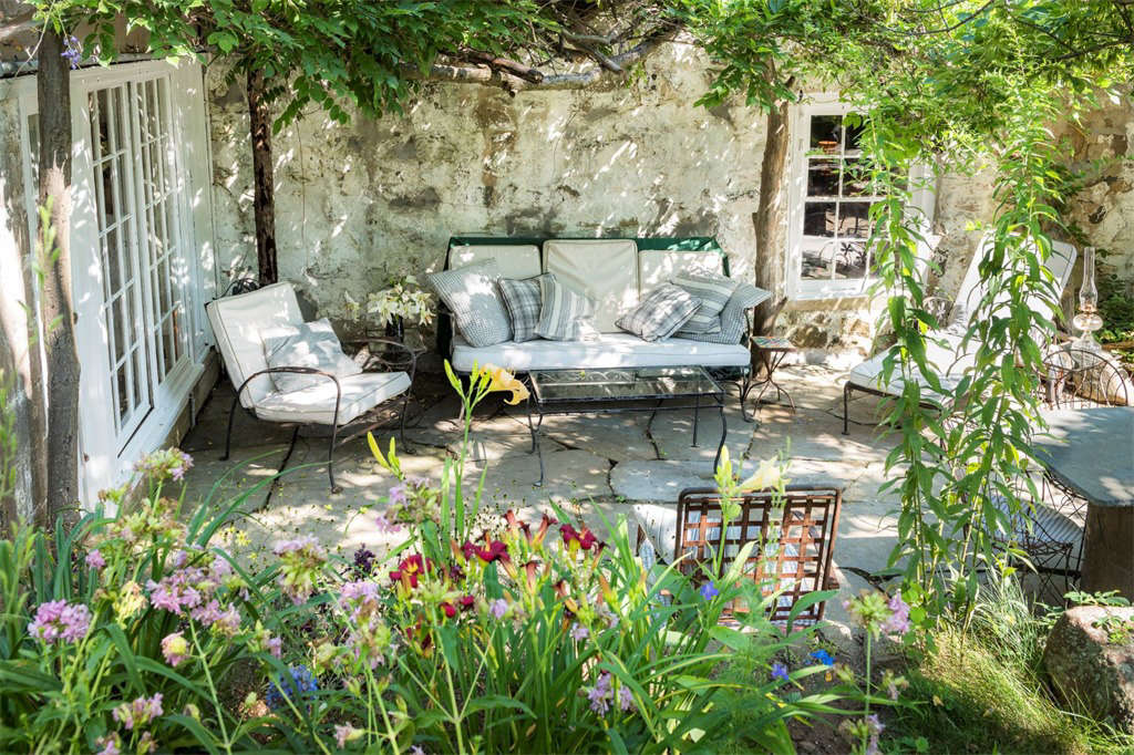 "A sunny terrace is just one of many inviting spots to plop down with a book (Tomkins owned so many that her personal library was in 1968 the subject of a newspaper feature story on ""living with books."")"