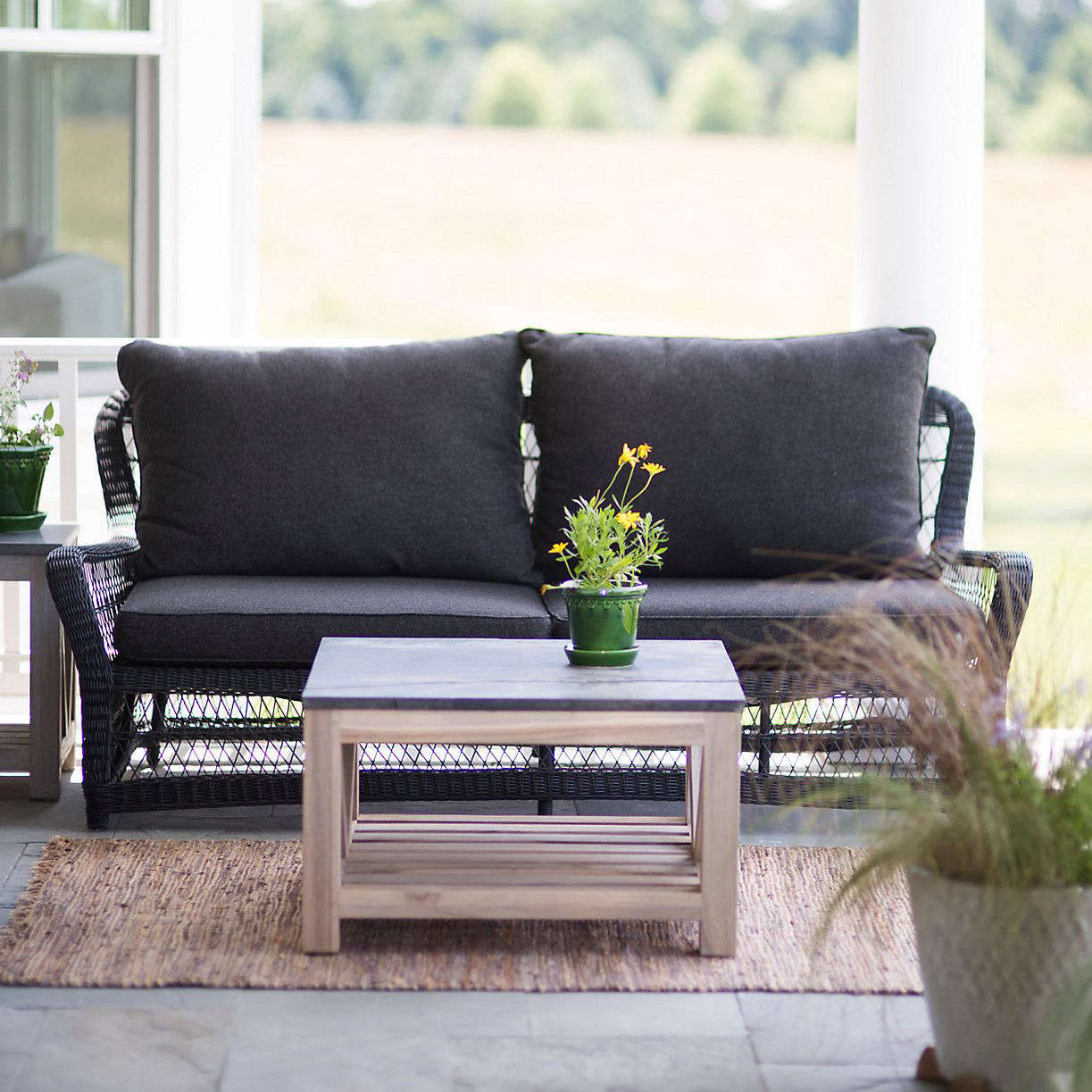 A 73-inch Curved All Weather Wicker SofaCurved All Weather Wicker Sofa is  31.5 inches - Object Of Desire: Classic Black Wicker Furniture - Gardenista