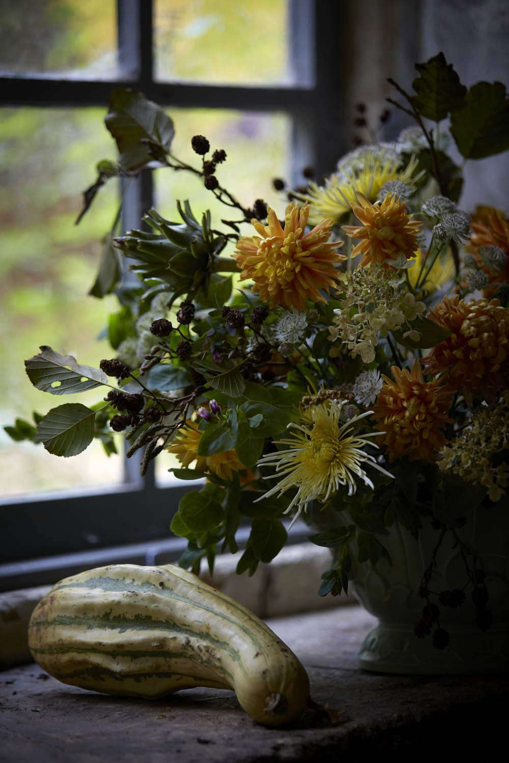 Something for late autumn. Orange and pale yellow chrysanthemums mix with white astrantia, branches of alder, and all manner of gourds and squashes.