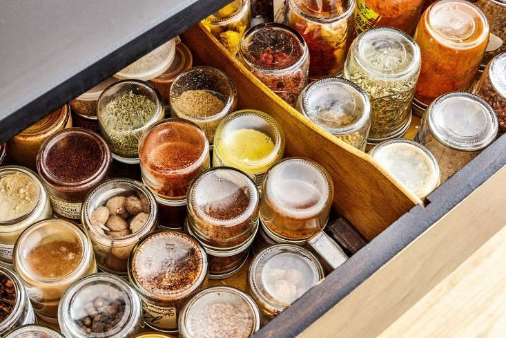 """Chef David Tanis stores his spices in jars arrayed upside-down in the dresser's top drawer. """"That way I can see what I've got, and I don't have to bother with labeling the jars,"""" he says. See more in Chef David Tanis's Low-Tech, Economical, and Beautifully Soulful Kitchen in the East Village."""