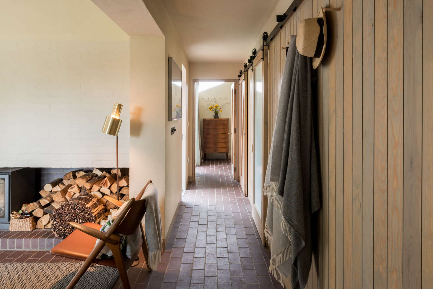 The brick fire surround in the living area contains a deep recess for logs and kindling.
