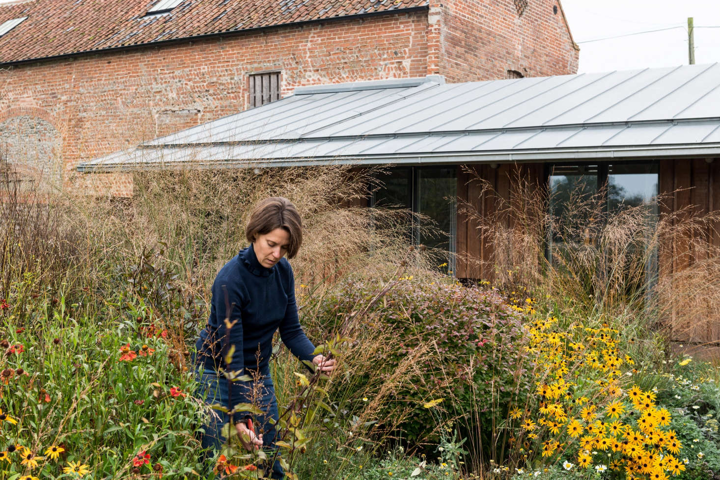 """""""The south east courtyard is exuberantly planted and was designed with rich autumnal colors in mind,"""" says Erlam."""