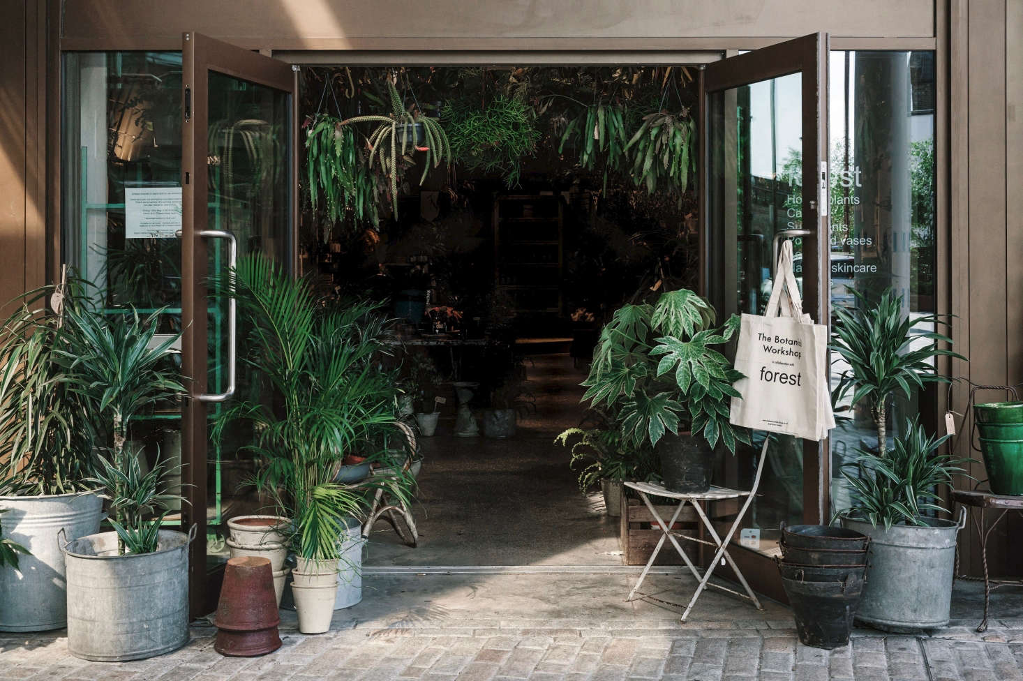 """Fran was originally looking for a workspace for her thriving floristry business, but as the original site is so close to a bustling shopping area she added some plants, pots, accessories and antiques. """"But then,"""" says Fran, """"The plant thing went boom."""""""