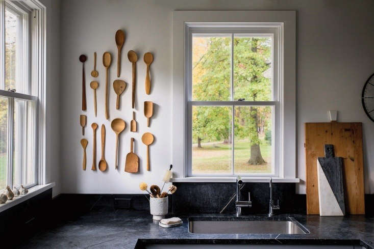 Source vintage wooden spoons on Etsy (they have a history and well-loved look) and hang them on the wall; utensil storage as art installation. See more in our Kitchen of the Week post.