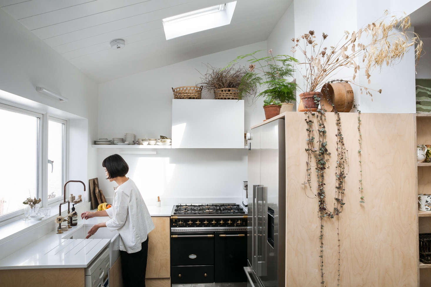 In Yasuyo's kitchen, golden grasses and dried flowers are elements in a botanical still life above the refrigerator.