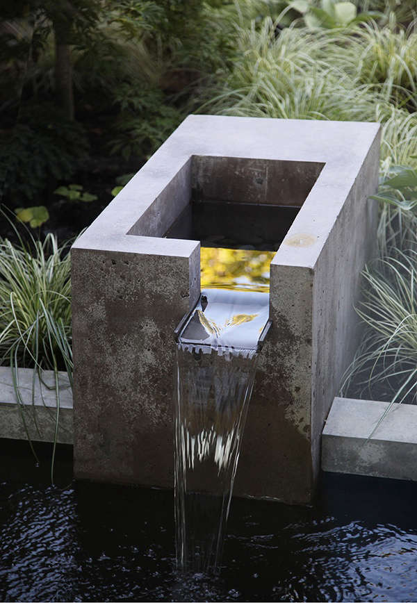 "The landscape architects designed an integrated fountain of concrete and bronze for the water feature, ""for its soothing sound as well as a focal point,"" Wittman says. Most of the new windows are operable so that the sound of water may be heard from inside the house."