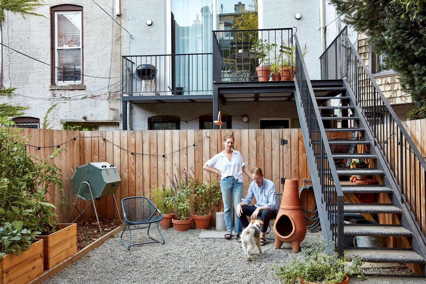 A Joraform Compost Tumbler, left, makes it easier to compost. Photograph by Jonathan Hökklo, from Sustainable Solutions: A Modern Garden for a Historic Townhouse in Brooklyn.