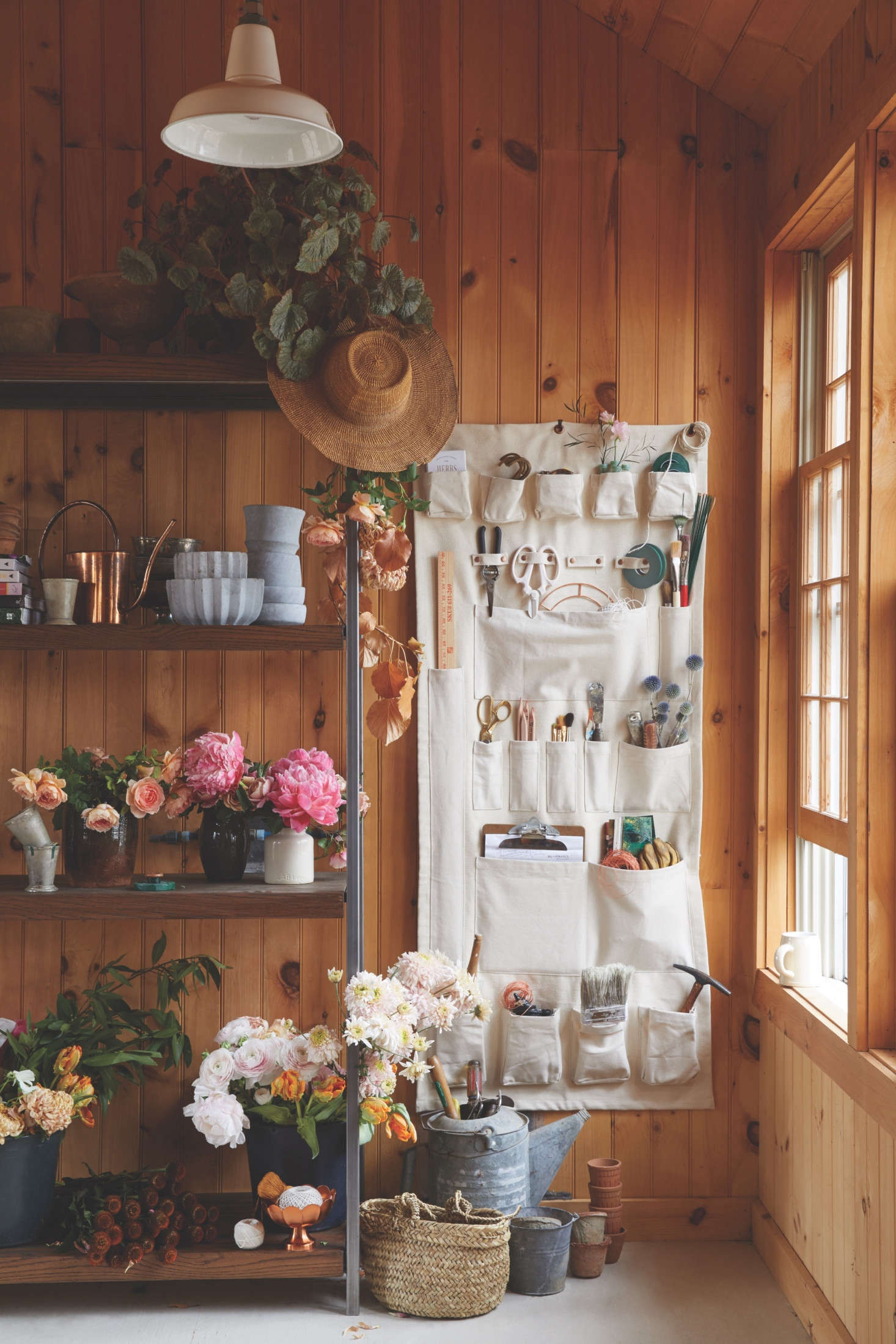 A cross between a gardening apron and a shoe pocket, The Floral Society Canvas Wall Organizer, $145.50, is a catchall that keeps tools tidy and within arm's reach. Steifman, who is a new mother, points out that it also works well in kids' rooms, as well as kitchens and offices.