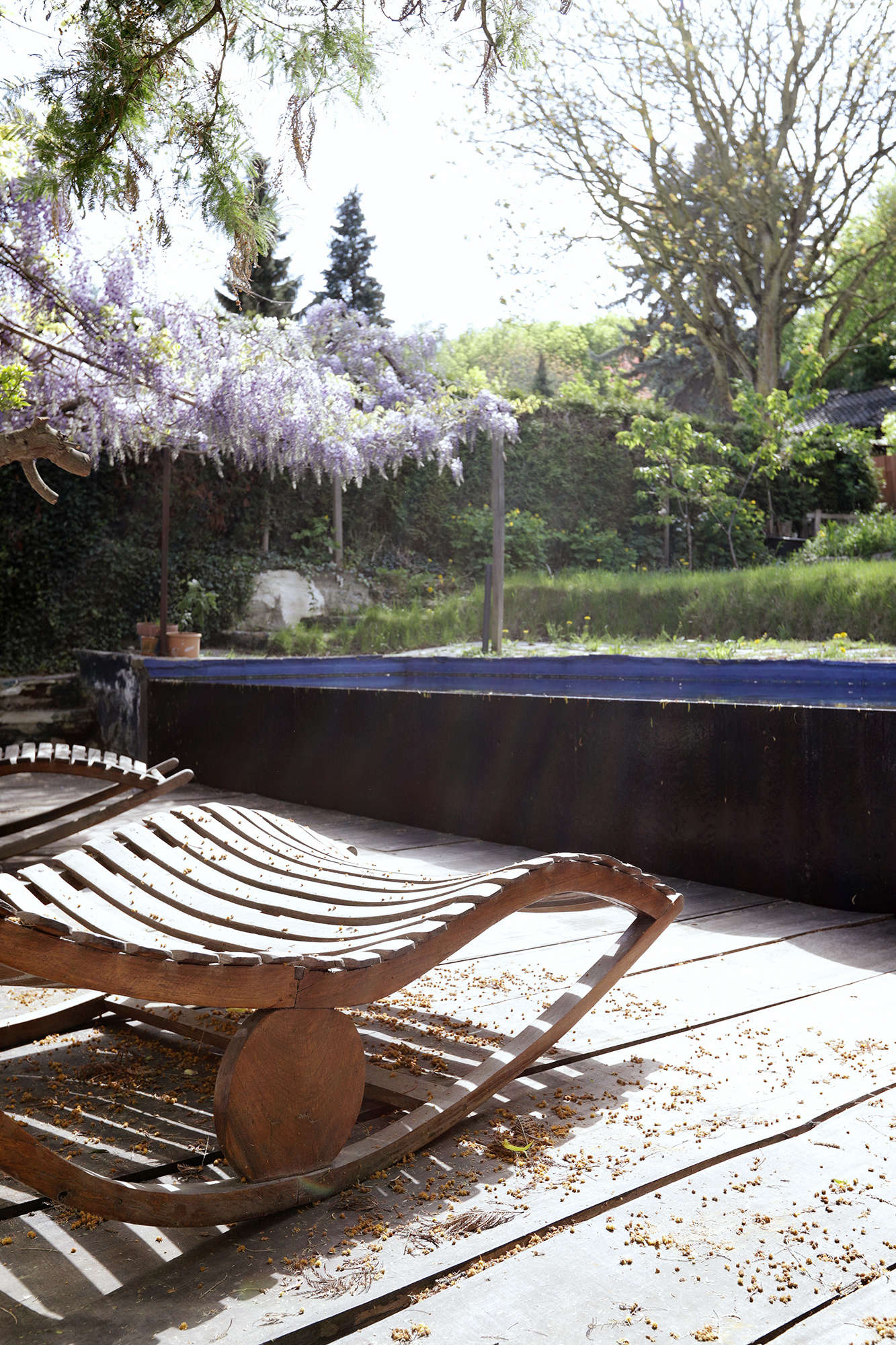 """The -meter-long (about 33-foot-long) pool is filled to the brim. """"When I swim the water is constantly falling over the front, but it adds a calm sound that works nicely with the Meuse river directly behind it.""""Valentin, who makes and designs wood furniture, installed the oak deck floors himself."""