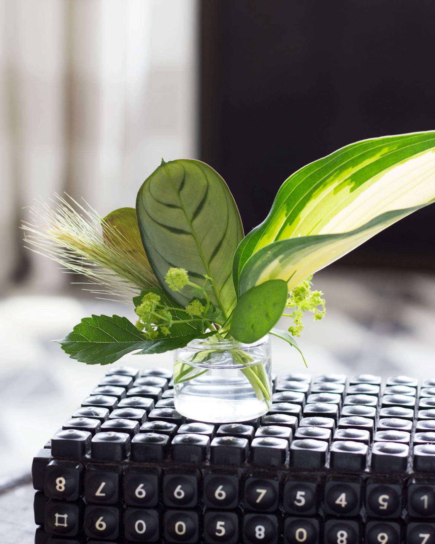Stark created a tiny arrangement of calathea hosta lady\u0027s mantle and grasses in & Tiny Bouquets: 8 Ideas for Floral Arrangements in Miniature Vases ...