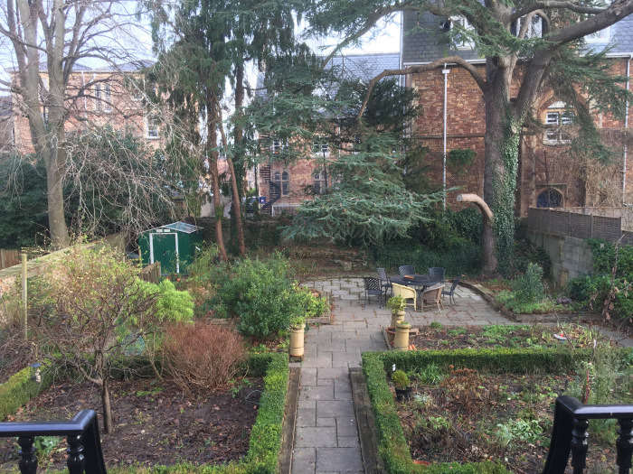 The courtyard had a generous footprint, but the neglected landscape was uninspiring.