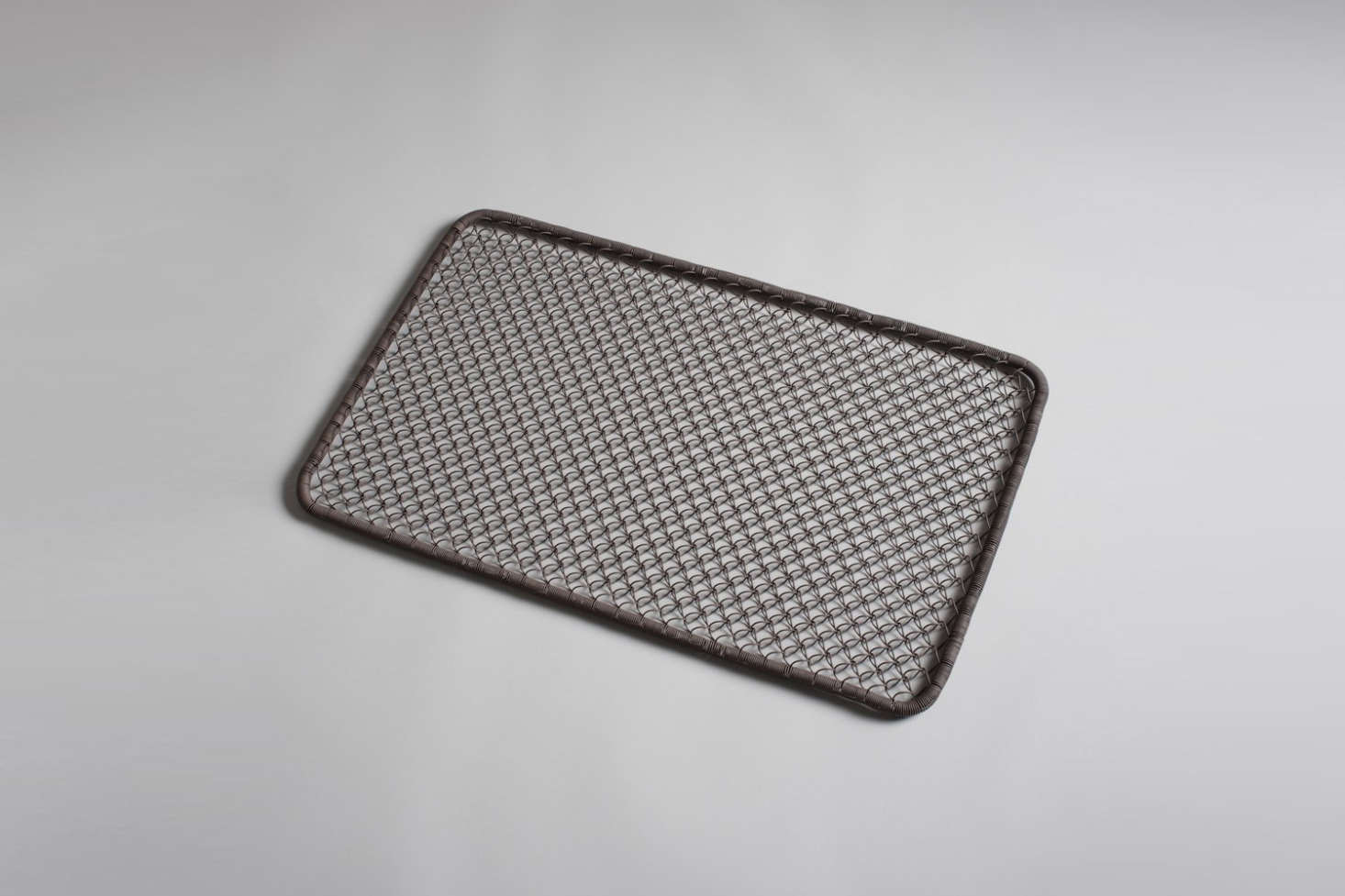 A Wire Doormat made of brown-tinted looped metal is $58 at Burkelman.