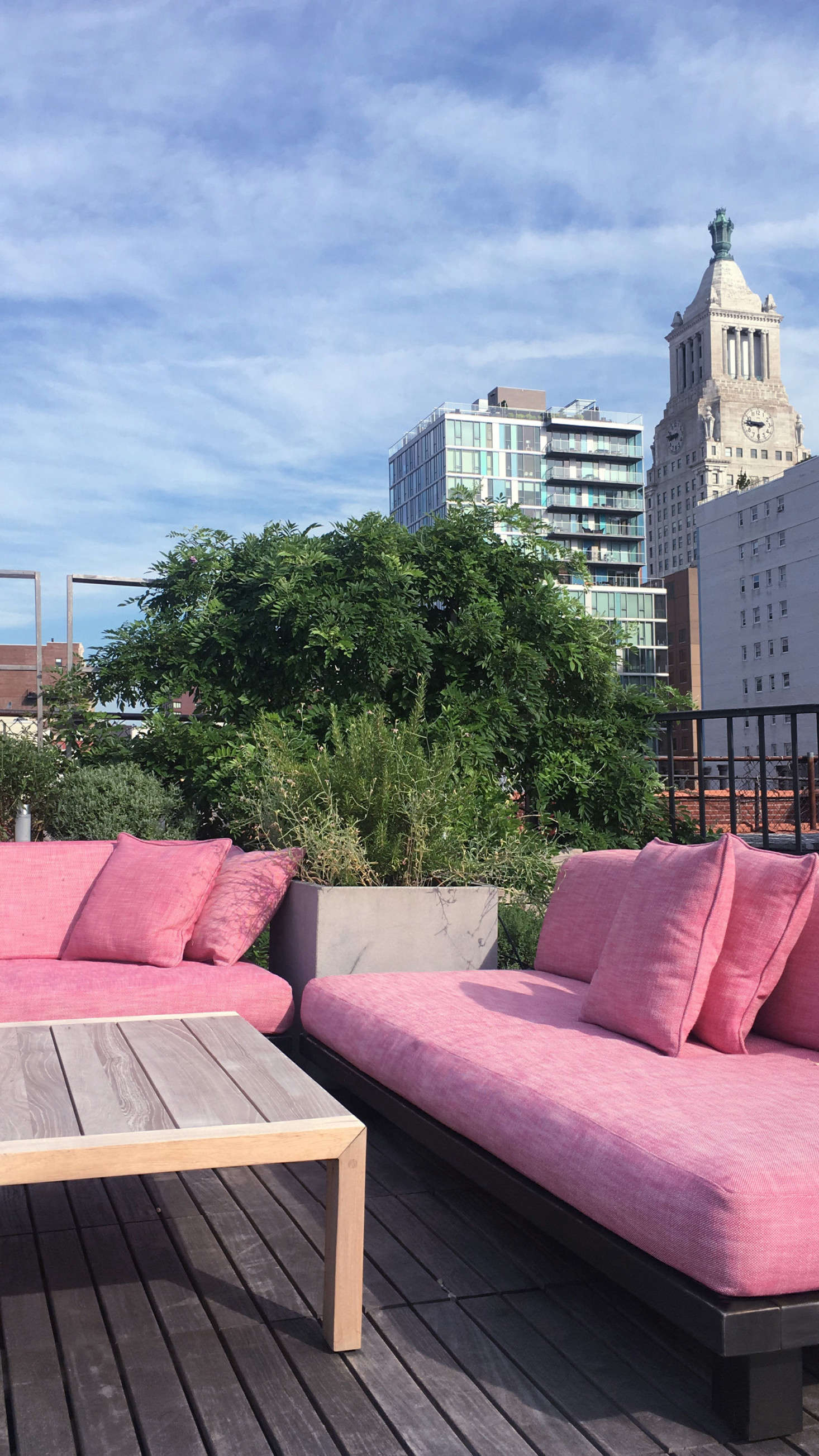 Ms. Keck purchased from West Elm two matching Tillary Sofas (no longer available) and had pink custom cushion covers made from Perennials outdoor fabric. With two identical sofas, &#8