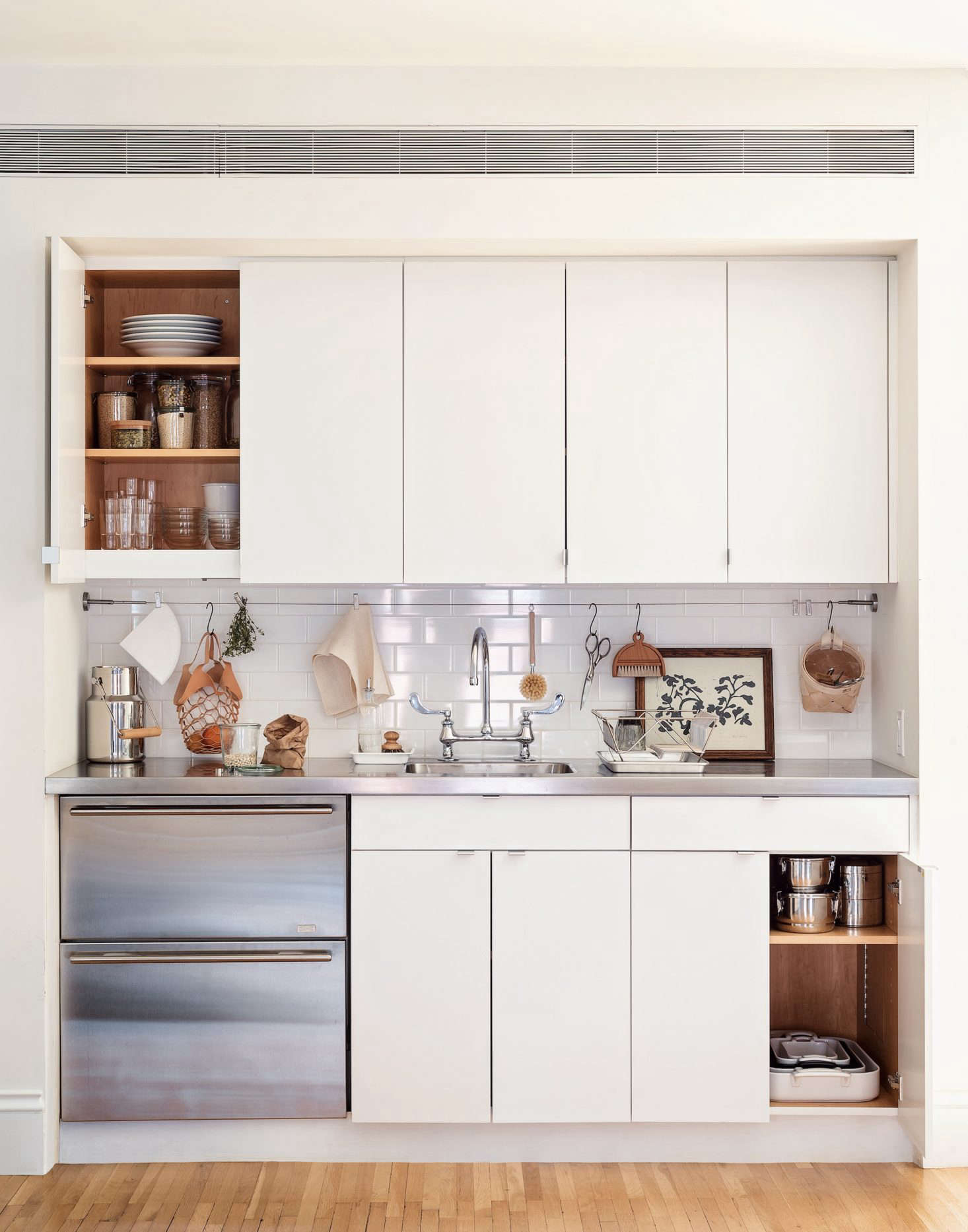 Take a page from this Brooklyn kitchenette and pare down the contents of your kitchen to just the essentials. You don't need 10 different pots and pans (in fact, you need only five), and are you ever going to use that Spiralizer? Photograph by Matthew Robbins from Remodelista: The Organized Home. See 5 Space-Saving Ideas to Steal from a Brooklyn Kitchenette, Ikea Hack Included.