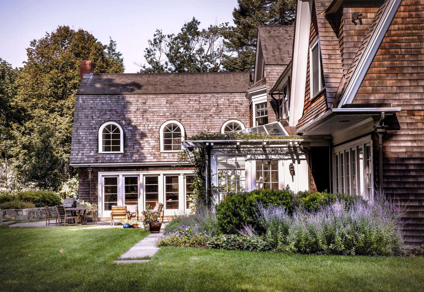 Adjacent to the house, a sheltered bluestone patio provides the main outdoor eating and entertaining area.