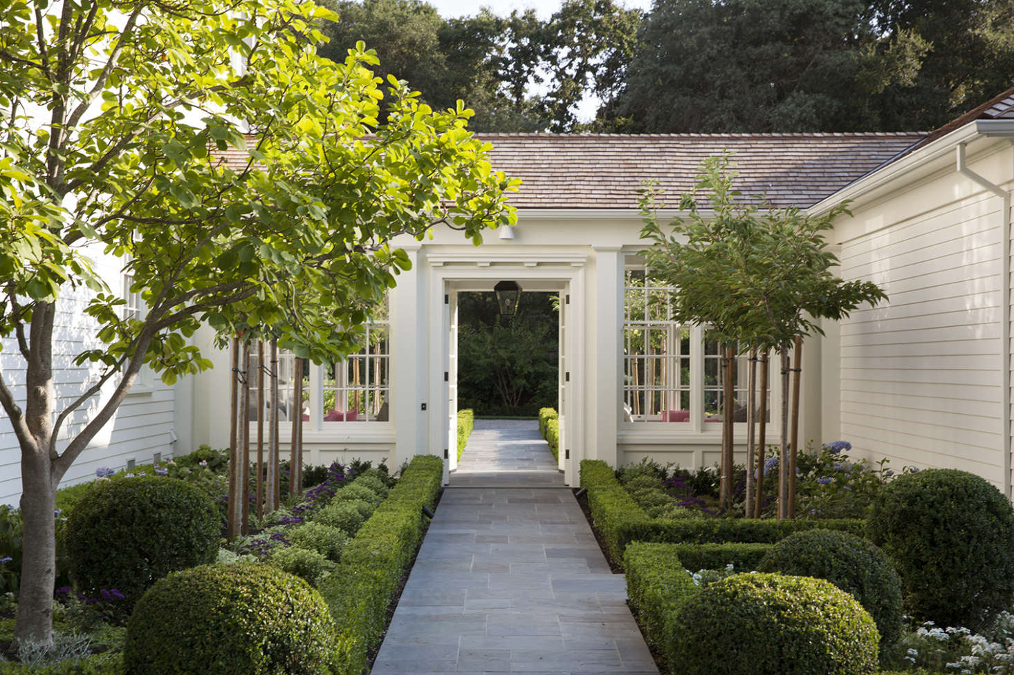 "San Francisco-based architect Ken Linsteadt used Benjamin Moore White Dove (OC-) for this Bay Area home. ""The color is fresh and crisp, yet soft enough to complement the surrounding gardens."" Photograph by Paul Dyer for Ken Linsteadt Architects; landscape architect Denler Hobart Gardens, from  Easy Pieces: California Architects&#8"