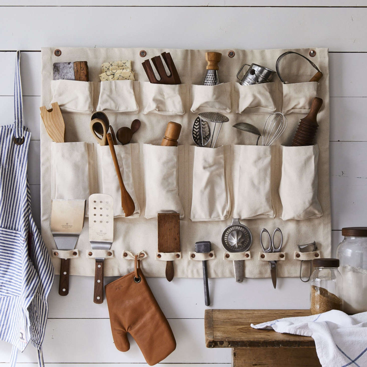 It's designed by a floral designer, but the canvas wall organizer is truly multi-purpose and can be used throughout the home—in the kitchen to corral cooking tools, in the closet to hold accessories (those straps would be a perfect place to hang your glasses), or in the bathroom to store toiletries.
