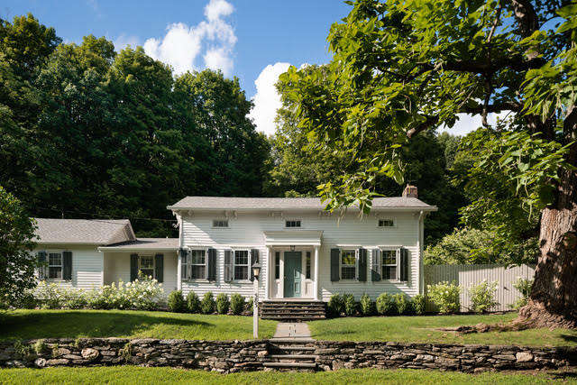 A favorite combination from Connecticut firm Hendricks Churchill is Farrow & Ball colorsPurbeck Stone (5),Inchyra Blue (9), and Black Blue (95). Seen here, the entire house is painted in Purbeck Stone (including the siding, trim, sash, and gutters). &#8