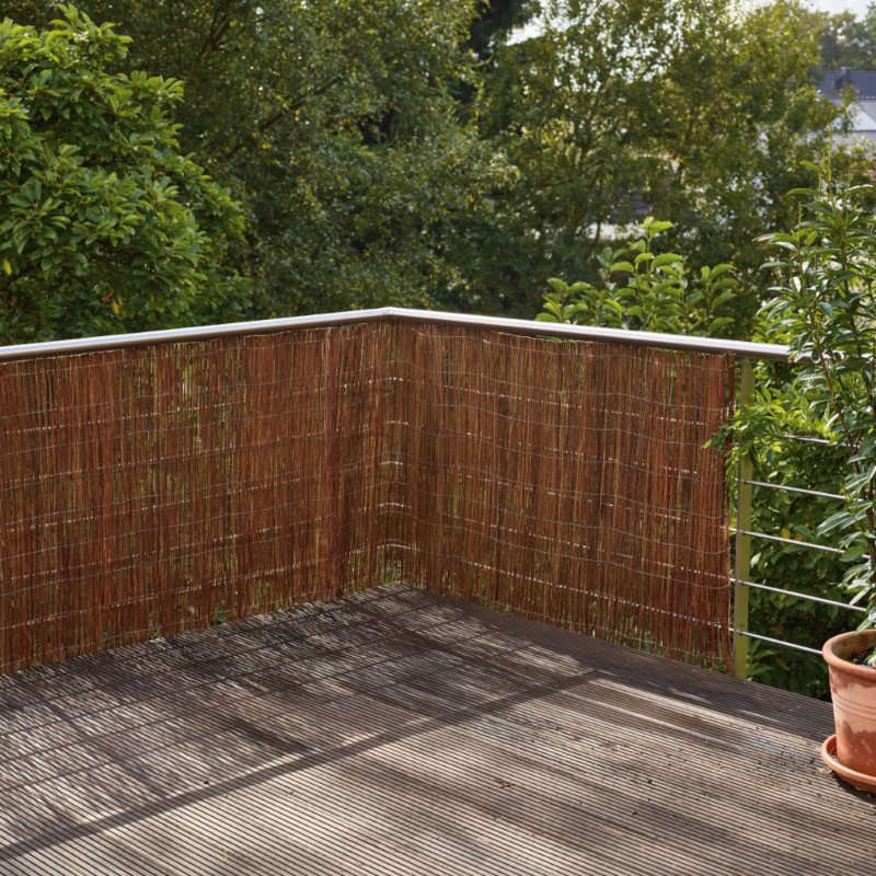 A balcony screen but notable for using with a slatted fence as well. The Manufactum Willow Balcony Screen is €48.