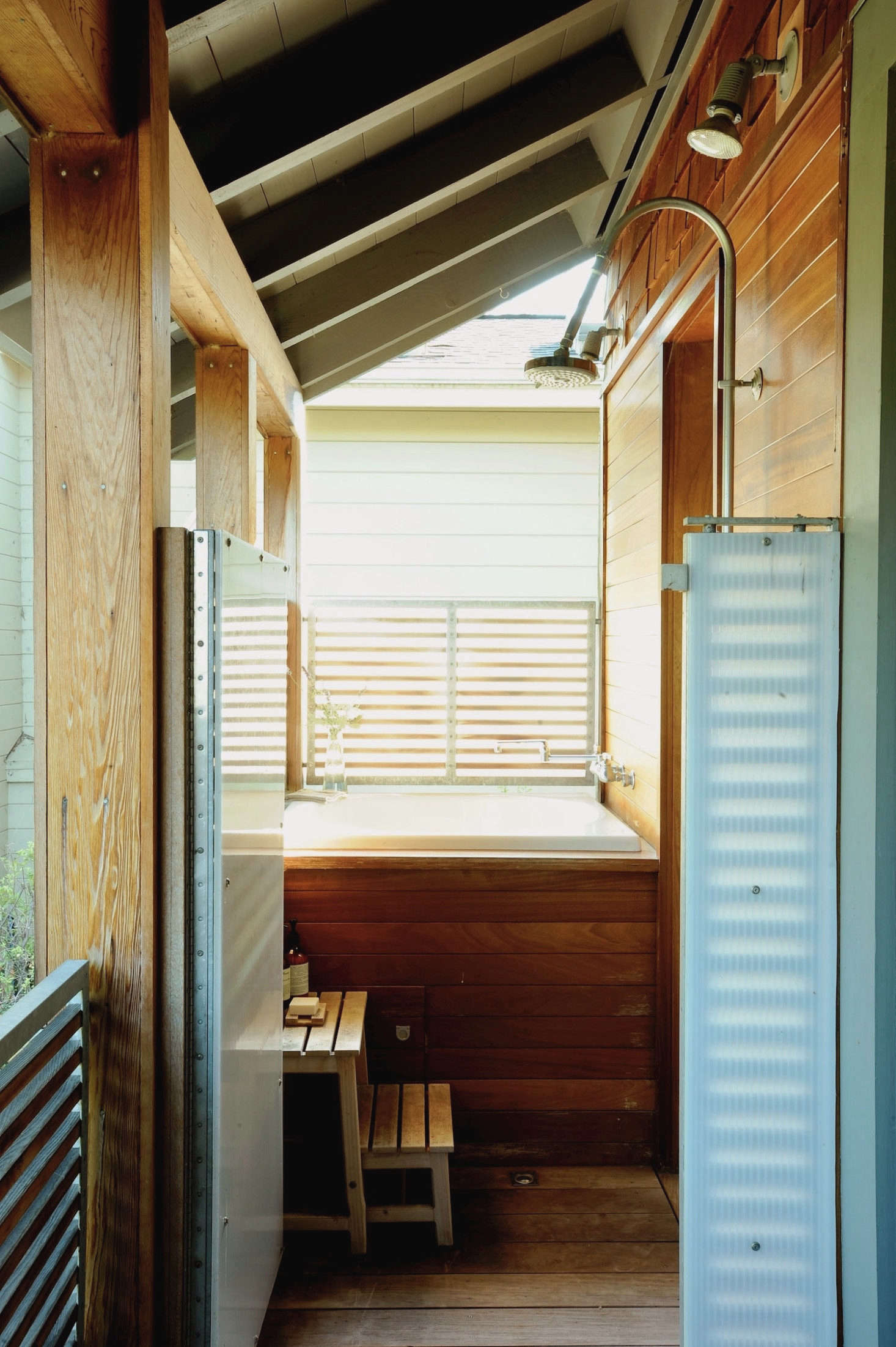 In Remodelista editor-in-chief Julie Carlson's outdoor shower in Mill Valley, architect Jerome Buttrick spec'd Polygal's Co-Extruded Polycarbonate Panels to create privacy while letting light through. Photograph by Matthew Williams for Remodelista. See more atGarden Hacks: 10 Ideas Under $100 to Create Instant Privacy.