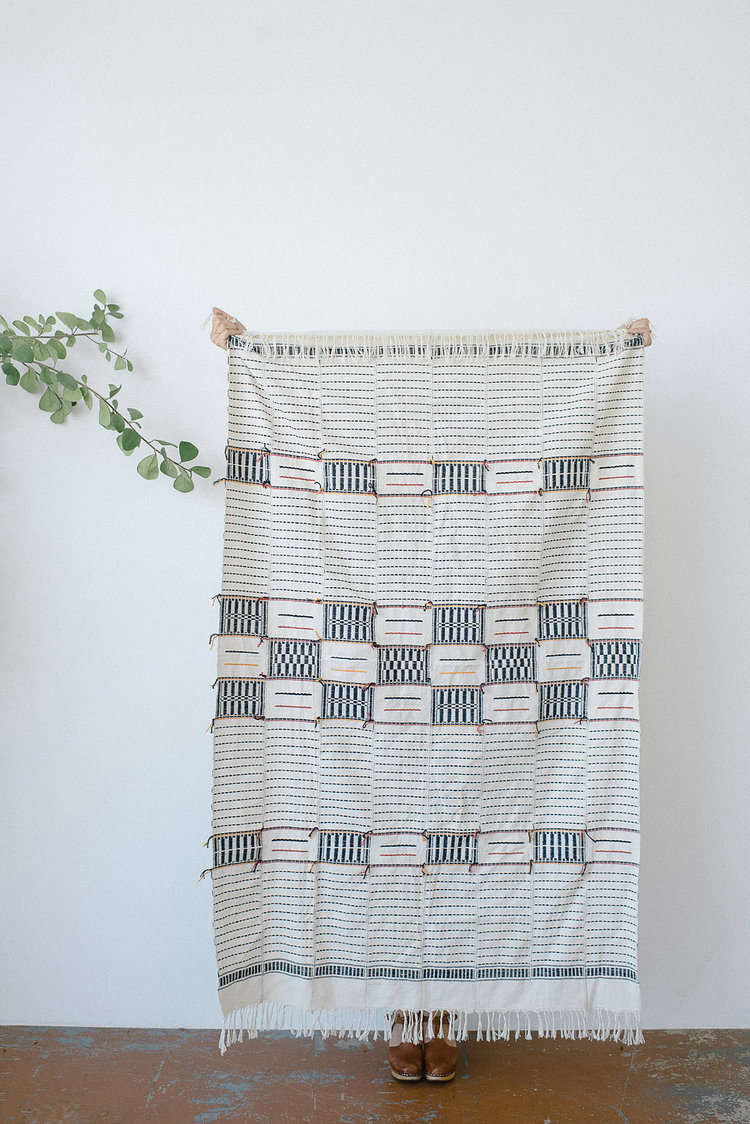 If you haven't done so already, swap your heavy wool blanket for something more like this beautifully woven cotton throw from Brooklyn-based Five | Six Textiles. See Five | Six Textiles: From Côte d'Ivoire, 'Mindfully Crafted' Bedspreads, Throws, and More.