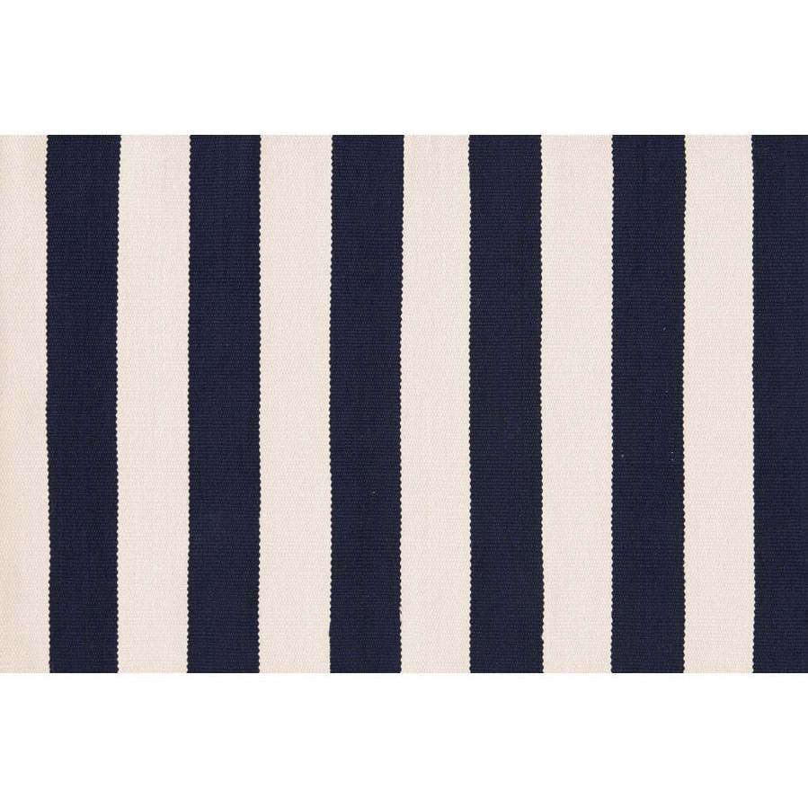 A bold classic, the Catamaran Stripe Outdoor Rug by Dash and Albert, shown in navy and cream, is $src=