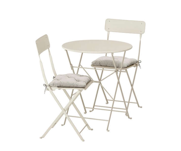 A must for small balconies, the powder-coated SALTHOLMEN tables and chairs, in beige, fold up for easy storage; $90.98.