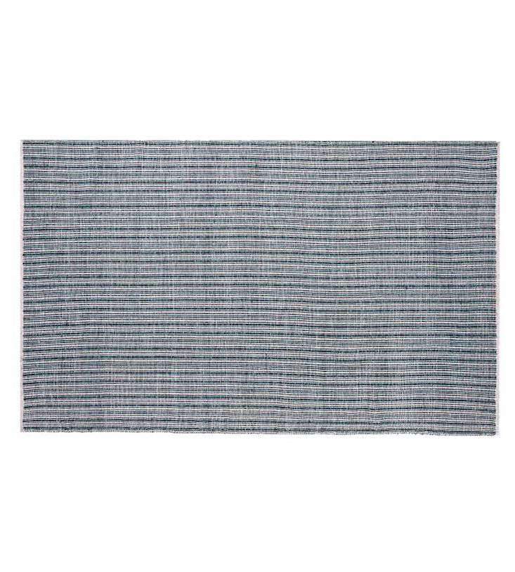 The Orson Synethic Indoor Outdoor Rug features appealingly subtle stripes; the 8 x  size is currently on sale for $349 at Pottery Barn.