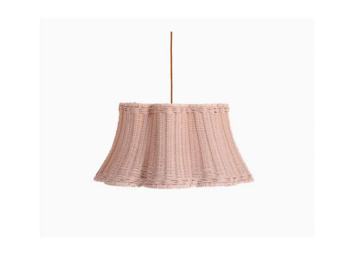 The old-fashioned material is back in a big way, and summer is the best time to bring it into your home. We're loving Soane Britain's handmade rattan lighting, like this Hanging Petal Light. See Summer Lights: Playful Rattan Lamps, Sconces, and Pendants by Soane Britain.