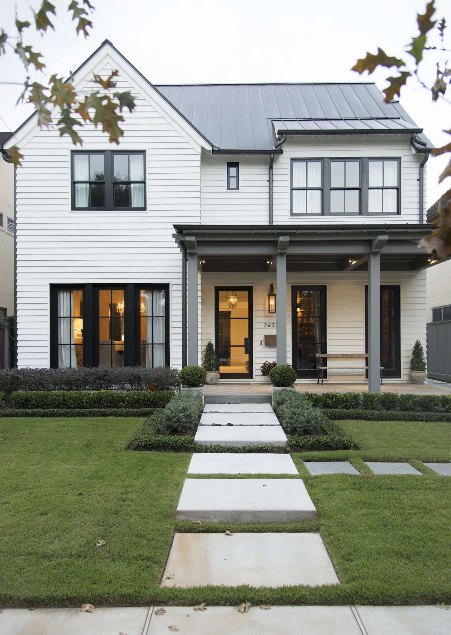 A Curb Appeal finalist in our2017 Considered Design Awards, theGranberry Residence in Houston, Texas, seamlessly integrates elements of classic farmhouse architecture with contemporary styling. Photograph by Megan Lovoi.